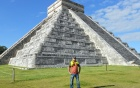 Photo of graduate student with Maya pyramid.