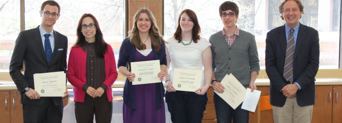 Photo of students receiving awards with faculty.