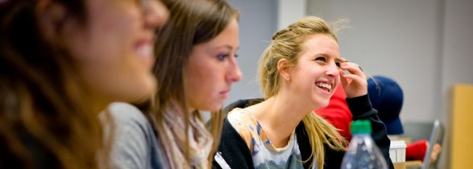 Students smile during a Communication undergraduate lecture.