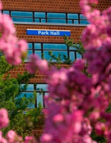 Park Hall framed by Spring Cheery Blossoms.