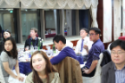 Young alumni in Korea, listening to opening remarks.