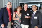 Alumni meet UB President Satish Tripathi (right) at a recent event.