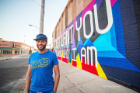 Artist Casey Milbrand in front of his I Just Want You to Know Who I Am Mural 982 Broadway St., Buffalo, N.Y. Scott Balzer photographer