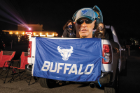 WEDNESDAY, NOV. 4, 7:47 P.M. DRIVE-IN FOOTBALL Fans tailgate with an outsize cutout of Coach Lance Leipold, while watching the Bulls play Northern Illinois at the Transit Drive-in. The nighttime spectacle was arranged to collectively—and safely—view the first game of a season delayed by the pandemic. The Bulls won 49-30. PHOTO BY MEREDITH FORREST KULWICKI