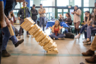 A giant Jenga tower topples to the floor of the Student Union during Engineers Week, an annual celebration. Photo by Douglas Levere.
