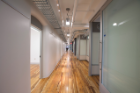 On the second and third floors, hallways were widened and brightened, while glass-walled offices share natural light and encourage interaction. Modular walls and rolling furniture allow for flexible, spontaneous changes to the building's layout.