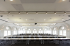 The original three-story auditorium is now a stunning 150-seat event hall and lecture space with restored moldings, arched windows and curvilinear ceiling.