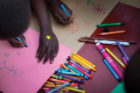 """I brought stickers with me and put them on all the kids' hands—they were a huge hit,"" says Cassandra Hamsher. Art supplies were also shared with the children, some of whom had never held a crayon or marker before. ""But once they learned, they went to town,"" says Cifra."