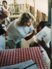 Gale Burstein working in a refugee camp clinic on the Thai-Cambodian border during medical school