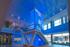 A 32-foot-tall light tower located inside the entrance lobby at Main and High streets, strikingly visible from outside the building, can be lit in virtually any color but is often seen beaming UB blue.