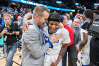 Coach Nate Oats congratulates senior guard Wes Clark, who led the Bulls with 26 points, five rebounds, three assists and four steals. Clark was named the MAC Tournament's Most Valuable Player.