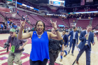 "It's ""horns up"" for Coach Felisha Legette-Jack as she leaves the court after her team's 102-79 victory over the South Florida Bulls."