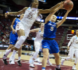 Florida State center Ama Degbeon and UB guard Katherine Ups battle for a rebound.