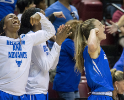 UB guard Stephanie Reid (right) and teammates react to a shot in the second half.