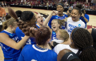 UB guard Stephanie Reid (center) and the rest of the team celebrate their upset of Florida State, 86-65, on Florida State's home court.