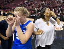 UB guard Katherine Ups and coach Felisha Legette-Jack both wipe their eyes at mid-court after celebrating their win over Florida State.