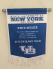 The team gave one of these banners, outlining the trip itinerary, to each club they played.
