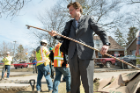 Edwards examines a length of pipe that supplied the home of Flint resident Elnora Carthan.