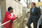 Edwards talks with Flint resident Lewis Spears, who participated in his water study.