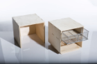 MULTIPURPOSE NESTING BOXES: Depending on how they're configured, these simple wooden nesting boxes can serve as end tables, stools or storage cubes, or can be combined to form a coffee table.