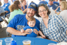 Steve Morris and Ruth Kleinman (BA '05) of New York, N.Y., enjoyed the tent party with their little boy in blue.
