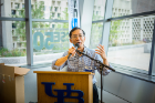 Chunming Qiao, SUNY Distinguished Professor and chair of the Department of Computer Science and Engineering, addresses a crowd at Davis Hall.
