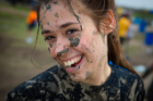 Student covered in mud at Oozefest.
