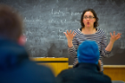 A professor lecturing to students.