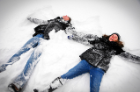 Students making snow angels.