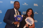 Two UB alumni posing in the photo booth at the Boldly Buffalo event in NYC.