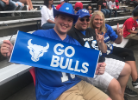 UB alumni with Go Bulls sign cheering on our football team.