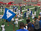 UB Bulls football players, cheerleaders and fans celebrating a win against Rutgers.