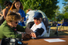 From Left Holly Johnson with Accessibility Resources, getting a blood test from UB on the Green in Front of Hayes Hall on the South Campus Photographer: Douglas Levere