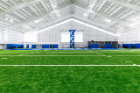 The UB Football team practices in the new Murchie Family Fieldhouse on the North Capus of University at Buffalo in April 2019. Photographer: Paul Hokanson