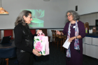 Director Carrie Bramen presents a gift to Isabel Marcus.