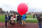 A weather balloon launch as part of a workshop led by Artists-in-residence Mick Lorusso and Joel Ong. Participants of this workshop deigned and built balloon payloads to capture airborne bacteria.