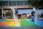 Members of the facilities team work to paint a new rainbow crosswalk design near the Student Union and UB Commons in August 2019. The Office of Inclusive Excellence helped organize the design and effort. Photographer: Meredith Forrest Kulwicki