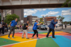 People gather to celebrate the ribbon cutting ceremony for the new rainbow crosswalk near the Student Union on North Campus in August 2019. The rainbow crosswalk involved Campus Living, Intercultural and Diversity Center, and the Office of Inclusive Excellence. Photographer: Meredith Forrest Kulwicki