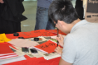 Student demonstrating calligraphy.