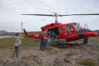 Members of the research team meet their helicopter. Left to right: UB geology undergraduate student Kayla Hollister; UB Assistant Professor of Geology Elizabeth Thomas; and Margie Turrin, education coordinator for Lamont-Doherty Earth Observatory at Columbia University. Credit: Anna McKee
