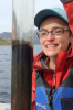 Elizabeth Thomas, UB assistant professor of geology, inspects a lake sediment core, which contains mud from the bottom of a Greenland lake. Such samples can be analyzed for clues about the history of precipitation in a region. Credit: Anna McKee