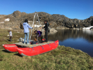 The researchers built a simple pontoon. They rode the boat into the middle of isolated lakes to collect samples of lake-bottom mud, which holds clues about the history of precipitation in a region. Credit: Elizabeth Thomas