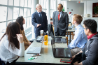 Alumni Gregg Fisher and President Satish K. Tripathi meet with students at the School of Management in March 2019.\r\rPhotographer: Douglas Levere
