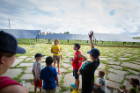 Sustainability Education Manager Erin Moscati (yellow shirt) gives campers from the UB Child Care Center a lesson on solar energy. Photo: Douglas Levere