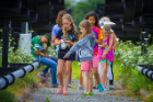 Campers take part in a nature-based scavenger hunt. Photo: Douglas Levere
