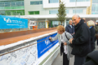 Jeremy Jacobs and his wife, Margaret, sign the beam. Photo: Douglas Levere