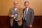 Joseph Gardella, a recipient of the Excellence in University-Community Engagement Award for Sustained Contributions, with Provost Charles Zukoski. Photo: Douglas Levere