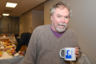 George DeTitta, UB professor of structural biology and research scientist at Hauptman-Woodward Medical Research Institute, shows off his Coppens mug.