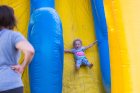 Kenedy Stockwell (right) enjoys the slide with her mother, Jessica Stockwell, at UB on the Green on July 19, 2017.