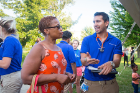 Yvette Gaines-Hicks (left) participates in a heath screening guided by nurrsing student Chris Streb (right) while at UB on the Green on July 19, 2017.